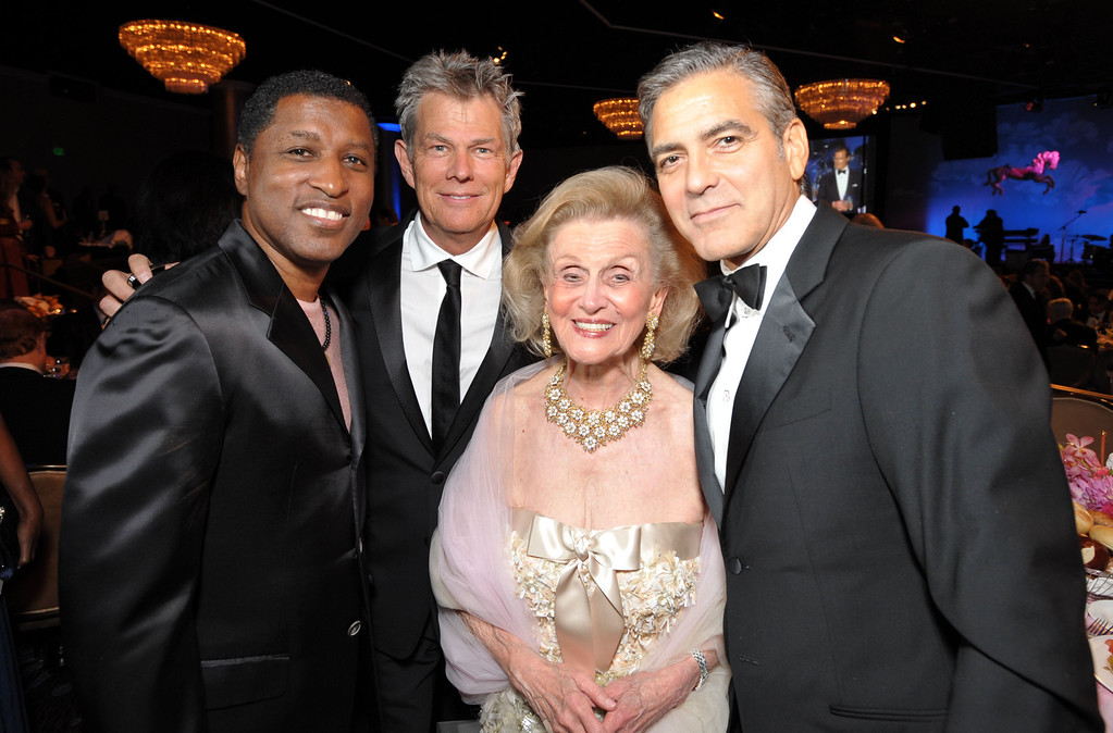 ". From left, Kenneth  ""Babyface\"" Edmonds, David Foster,  Barbara Davis, and George Clooney attend The Carousel of Hope at The Beverly Hilton Hotel on Saturday, Oct. 20, 2012, in Beverly Hills. (Photo by John Shearer/Invision/AP)"