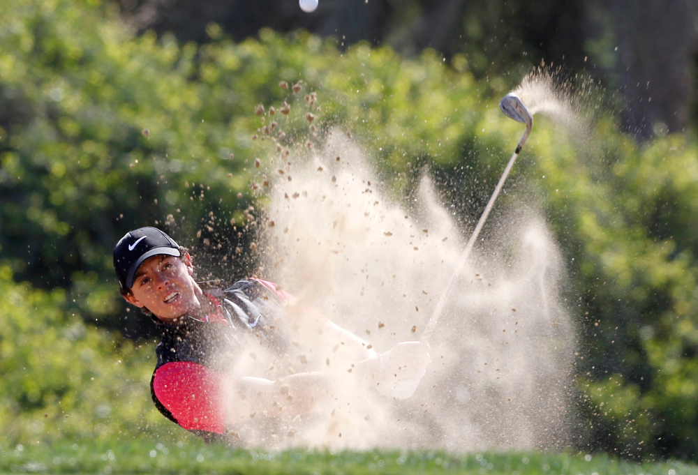 Description of . Rory McIlroy of Northern Ireland hits out of a bunker at the seventh hole during the first round of the Abu Dhabi Golf Championship at the Abu Dhabi Golf Club January 17, 2013. REUTERS/Ahmed Jadallah