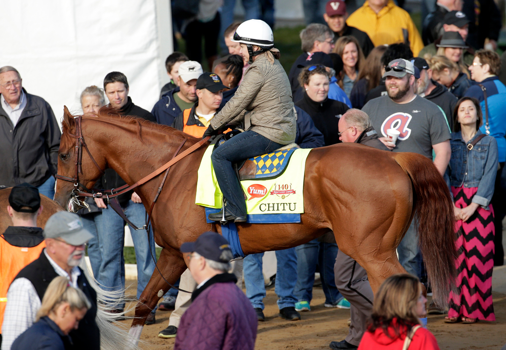 . Exercise rider Dana Barnes takes Kentucky Derby entrant Chitu for a morning workout at Churchill Downs Thursday, May 1, 2014, in Louisville, Ky. (AP Photo/Charlie Riedel)