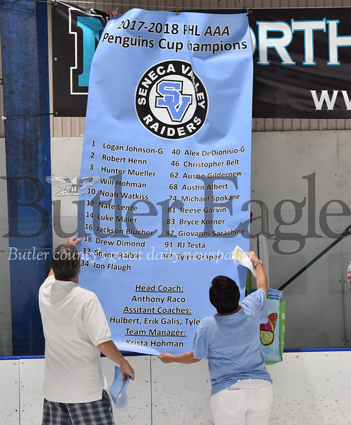 53067 Seneca Valley Penguins Cup championship banner being put up at Bairl Ice Arenaw