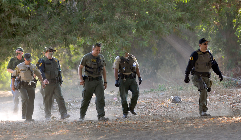 . Los Angeles County Sheriff\'s Deputies search for homeless individuals camping in the river bed area of the San Gabriel River near South El Monte on Thursday September 12, 2013. (Whittier Daily News/Staff Photo by Keith Durflinger)