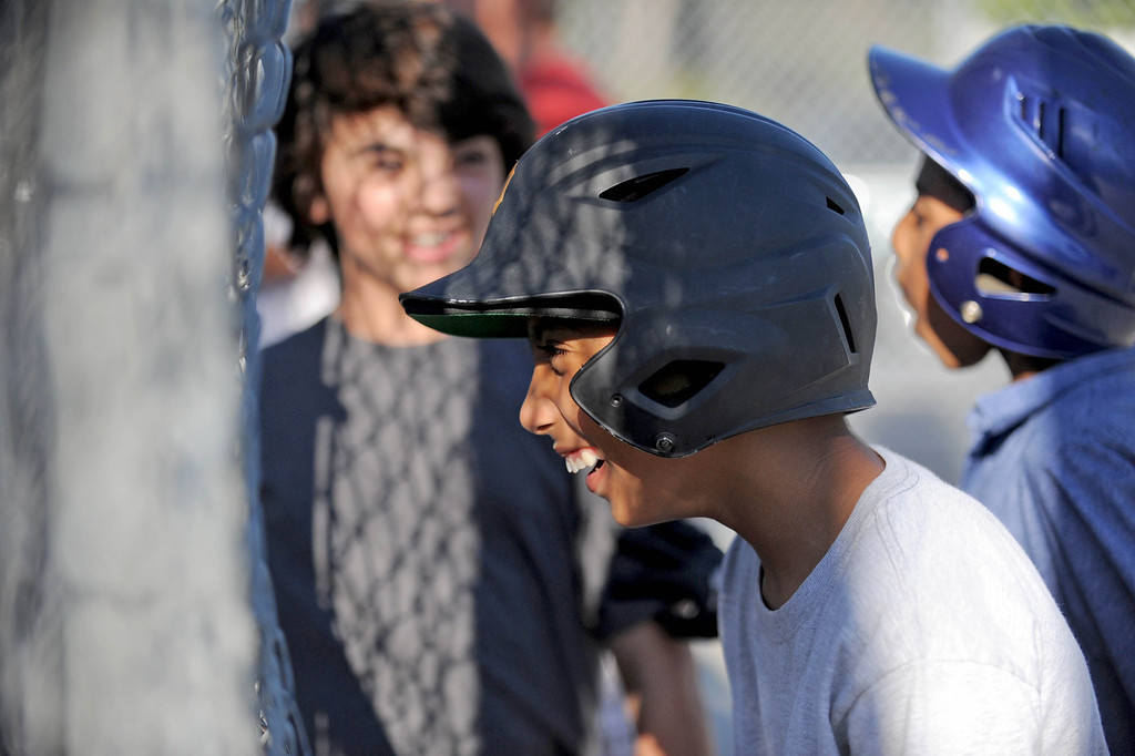 . 05-10-2013-(LANG Staff Photo by Sean Hiller)-  Lakewood Batting Cages located on Paramount and Cover Street is going out of business after 27 years  after their lease was not renewed. Nathan Blair, 12, of the Lakewood Village Little League Major Pirates, center, enjoys time with teammates Caden Steele ,12, left, and  Miles Perry,11, right, while waiting for a turn to bat.