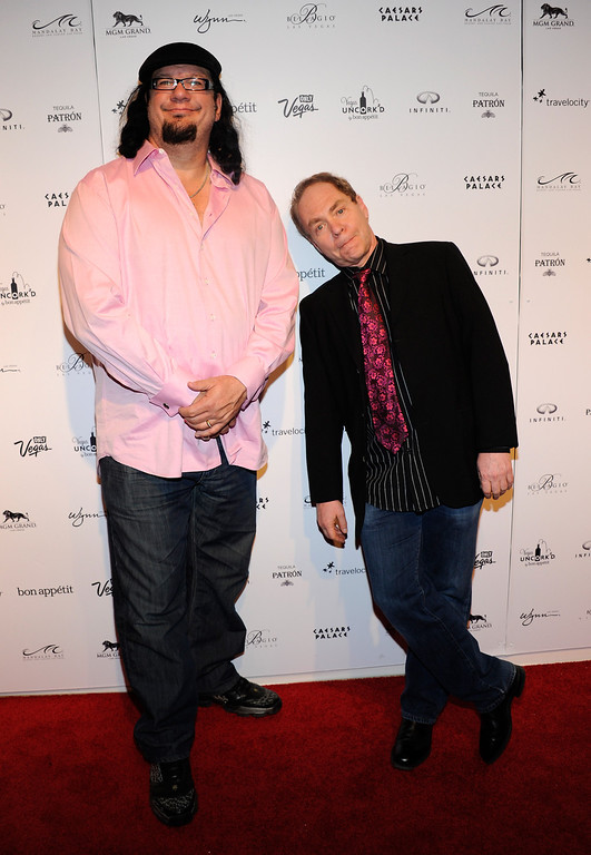 . LAS VEGAS, NV - MAY 06:  Penn Jillette (L) and Teller of the comedy/magic team Penn & Teller arrive at Vegas Uncork\'d by Bon Appetit\'s Grand Tasting event at Caesars Palace May 6, 2011 in Las Vegas, Nevada.  (Photo by Ethan Miller/Getty Images for Caesars Entertainment)