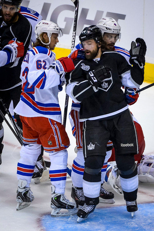 . Rangers Carl Hagelin and Kings Justin Williams get in a confrontation during second period action at Game 1 of the Stanley cup Finals at Staples Center Wednesday, June 4, 2014 ( Photo by David Crane/Los Angeles Daily News )