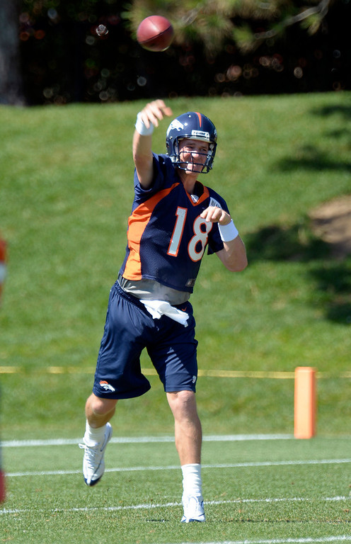 . Denver Broncos quarterback Peyton Manning (18) throws a pass during practice August 19, 2013 at Dove Valley (Photo by John Leyba/The Denver Post)