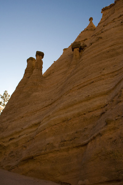 """Notice how these stones, which are just a few inches across, have protected the material below from erosion. This is how the """"tent rocks"""" are created."""