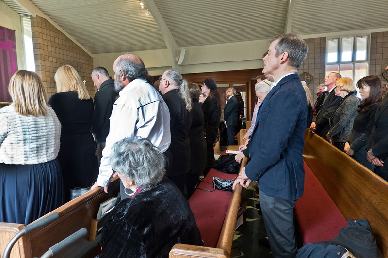 People in pews at Pearl Clarke Funeral Mass and life celebration at St. Denis Catholic Church.