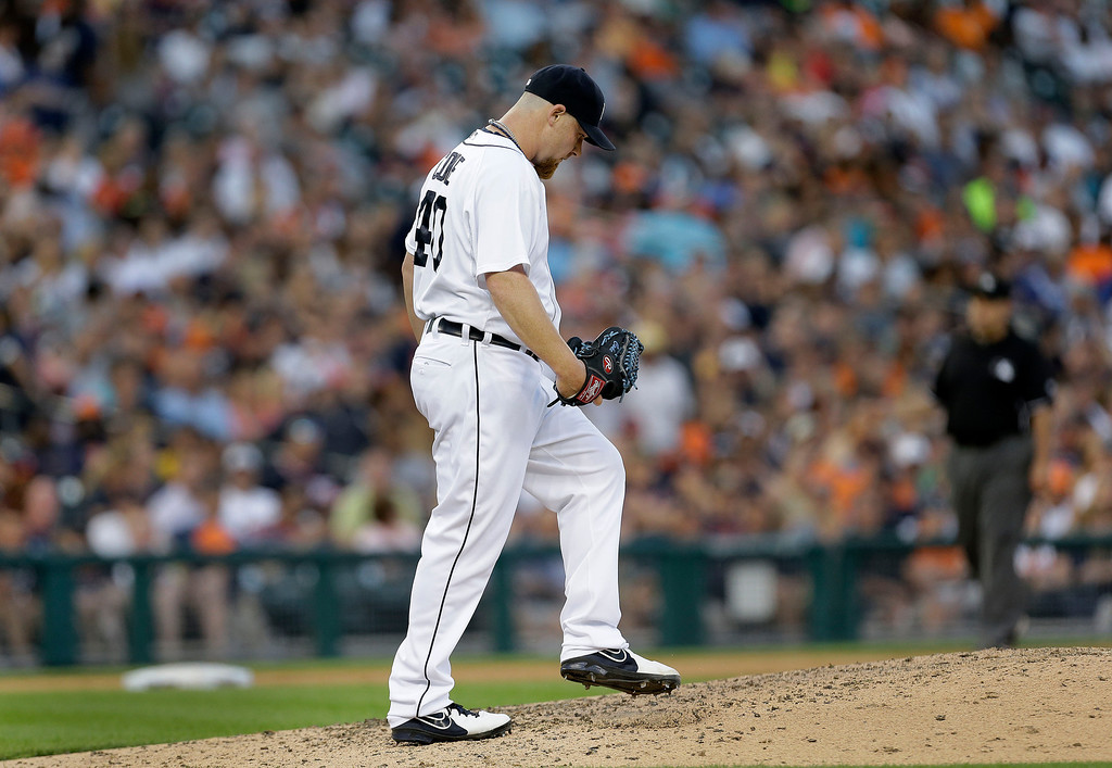 . Detroit Tigers relief pitcher Phil Coke walks back to the mound after walking Kansas City Royals\' Omar Infante with the bases loaded to score Alcided Escobar in the fifth inning of a baseball game in Detroit, Tuesday, June 17, 2014.  (AP Photo/Paul Sancya)