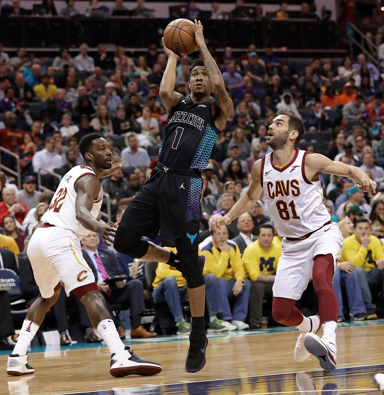 . Charlotte Hornets\' Malik Monk (1) drives between Cleveland Cavaliers\' Jose Calderon (81) and Jeff Green (32) during the first half of an NBA basketball game in Charlotte, N.C., Wednesday, March 28, 2018. (AP Photo/Chuck Burton)