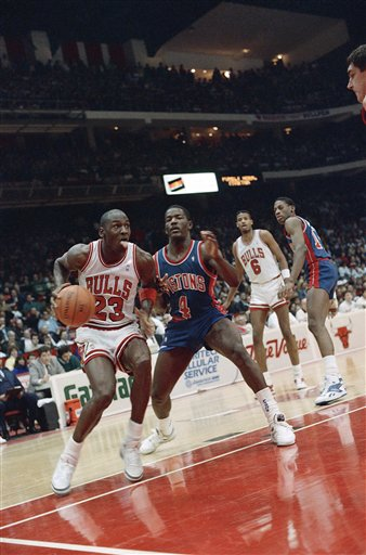 Description of . Chicago Bulls' Michael Jordan (23) sticks out his tongue as he shoots past Detroit Pistons' Joe Dumars (4) during game at night on Tuesday, Feb. 10, 1988 in Chicago. The Pistons beat the Bull 89-74. (AP Photo/Fred Jewell)