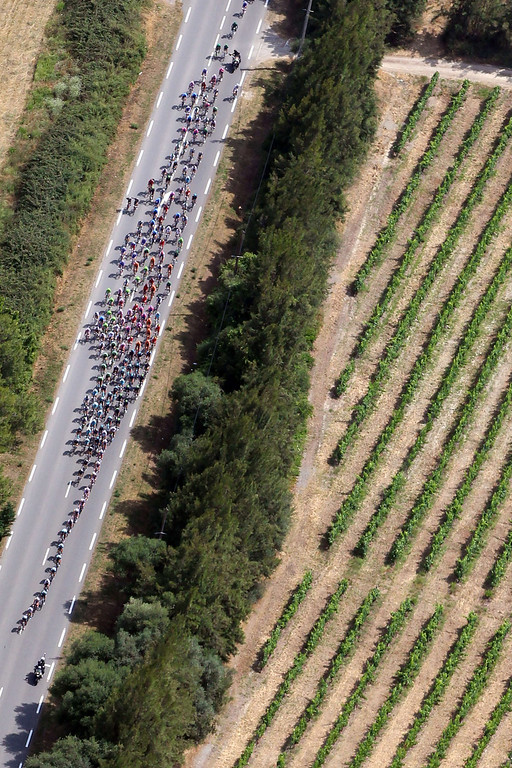. The pack rides during the first stage of the 100th edition of the Tour de France cycling race on June 29, 2013 between Porto-Vecchio and Bastia, on the French Mediterranean Island of Corsica. PASCAL POCHARD CASABIANCA /AFP/Getty Images