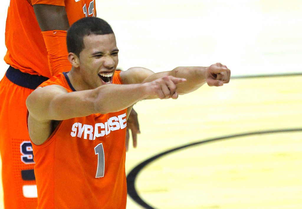 . Syracuse Orange guard Michael Carter-Williams reacts after defeating the Indiana Hoosiers in their East Regional NCAA men\'s basketball game in Washington, March 28, 2013.  REUTERS/Gary Cameron