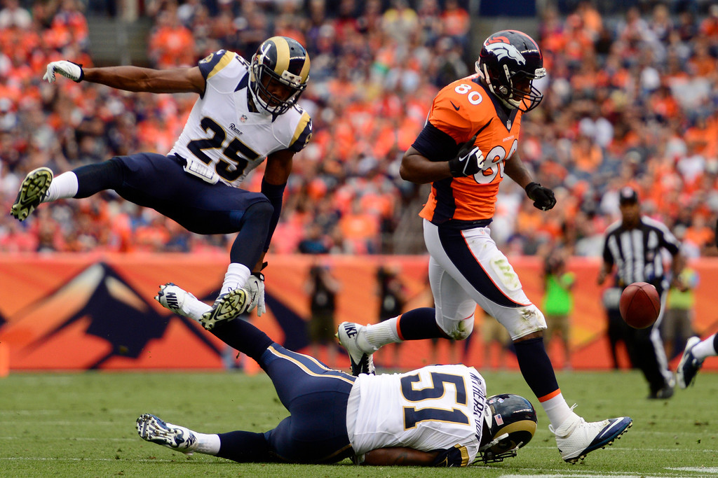 . DENVER, CO - AUGUST 24: T.J. McDonald (25) of the St. Louis Rams and Daren Bates (51) collide as Julius Thomas (80) of the Denver Broncos reacts to an incomplete pass during the first half of action of an NFL preseason game at Sports Authority Field at Mile High on August 24, 2013. This is the third game of the preseason for the Broncos. (Photo by AAron Ontiveroz/The Denver Post)