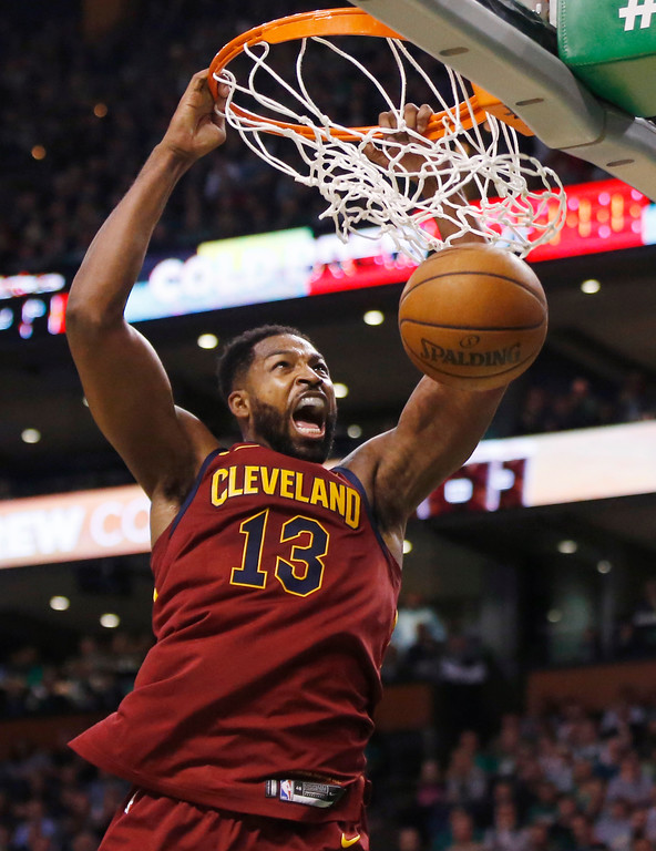 . Cleveland Cavaliers center Tristan Thompson (13) dunks during the first half of Game 1 of the NBA basketball Eastern Conference Finals against the Boston Celtics, Sunday, May 13, 2018, in Boston. (AP Photo/Michael Dwyer)