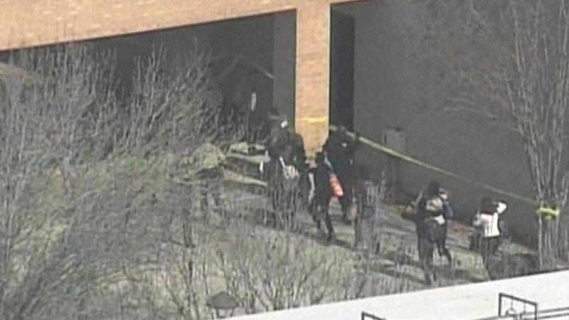 . People run from a building on the Lone Star College Campus near Houston, Texas in this still image taken from video courtesy of KPRC-TV Houston January 22, 2013.  Multiple people have been shot according to news reports.  REUTERS/KPRC-TV Houston/Handout