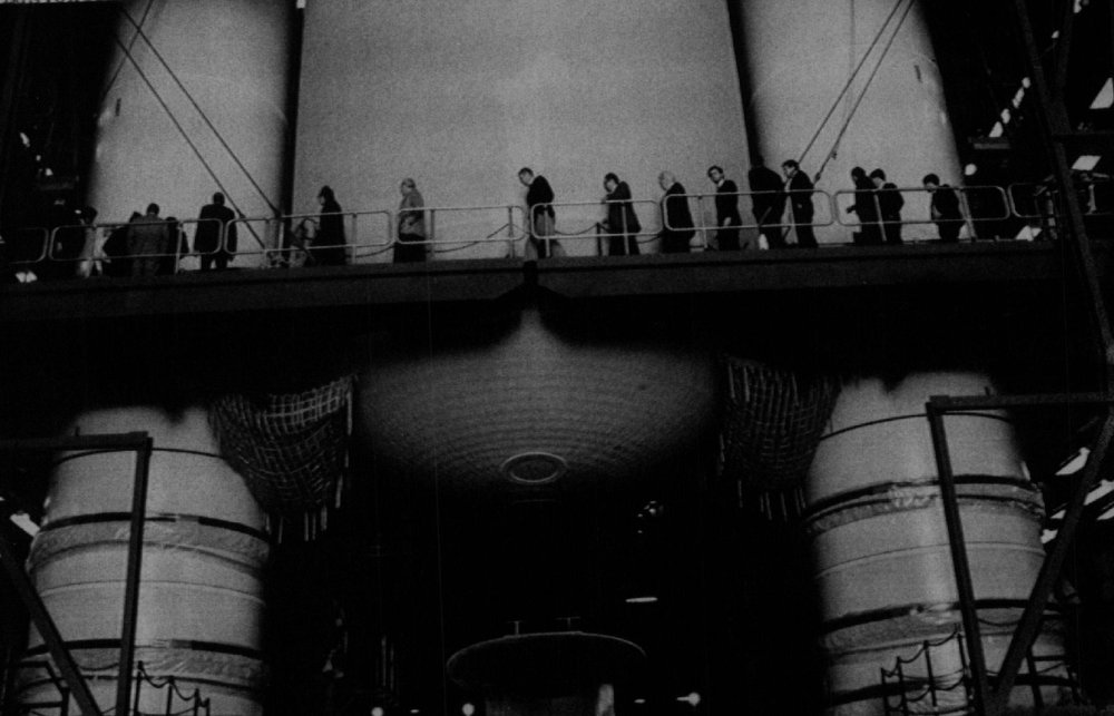 Description of . The Presidential Commission on the Space Shuttle Challenger Accident walk in front of two solid rocket boosters and the external tank being fitted in the Vehicle Assembly Building at Kennedy Space Center on April 1, 2986. The commission is at KSC following the explosion of Space Shuttle Challenger on Jan. 28th to try and determine the cause.  Denver Post Library Archive