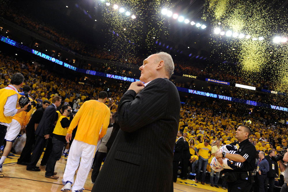 . George Karl of the Denver Nuggets takes off his tie as he walks off the court after their loss to the Golden State Warriors 115-101 in Game 4 of the first round NBA Playoffs April 28, 2013 at Oracle Arena. (Photo By John Leyba/The Denver Post)
