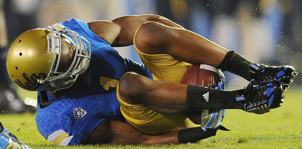 . UCLA wide receiver Shaquelle Evans (1) catches a pass between his legs for a first down during the first half of their college football game against California in the Rose Bowl in Pasadena, Calif., on Saturday, Oct. 12, 2013.   (Keith Birmingham Pasadena Star-News)