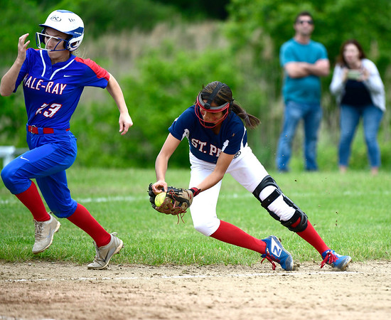 5/30/2019 Mike Orazzi | Staff St. Paul's Janessa Gonzalez (24) and Hale Ray's Carly Houle (23) during a 6-4 St. Paul win in a Class S Second Round softball game in Bristol Thursday.