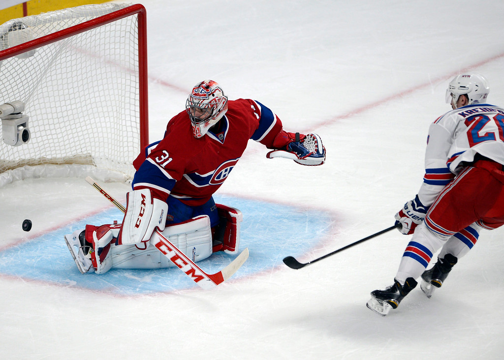 . New York Rangers left wing Chris Kreider (20) scores past Montreal Canadiens goalie Carey Price during the second period in Game 1 of the Eastern Conference finals in the NHL hockey Stanley Cup playoffs in Montreal on Saturday, May 17, 2014. (AP Photo/The Canadian Press, Ryan Remiorz)