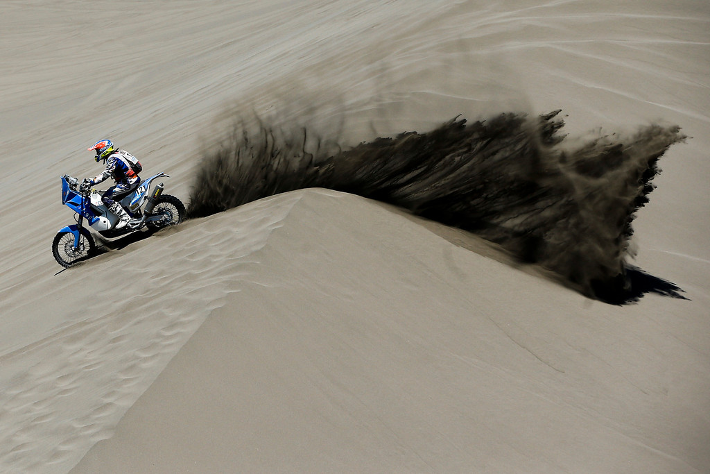 . KTM rider Mark Davidson of Australia races through the dunes during the second stage of the Dakar Rally between the cities of San Luis and San Rafael in San Rafael, Argentina,  Monday, Jan. 6, 2014. The second stage is regarded as one of the fastest in the two-week rally, which ends Jan. 18 in Valparaiso, Chile. (AP Photo/Victor R. Caivano)