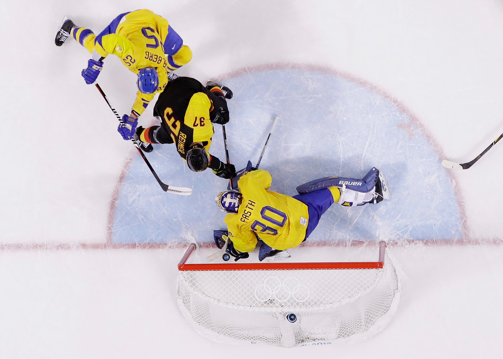 . Patrick Reimer (37), of Germany, shoots the puck past Viktor Fasth, of Sweden, for the game winning goal during the overtime period of the quarterfinal round of the men\'s hockey game at the 2018 Winter Olympics in Gangneung, South Korea, Wednesday, Feb. 21, 2018. (AP Photo/Frank Franklin II)