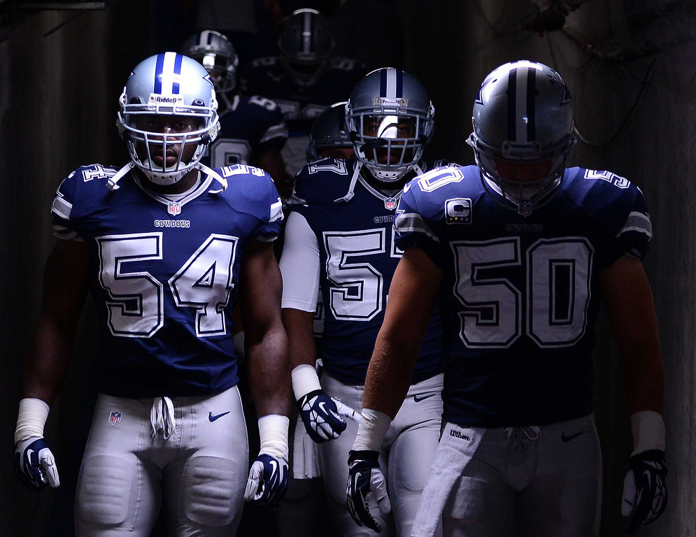 . SAN DIEGO, CA - SEPTEMBER 29:  Bruce Carter #54 and Sean Lee #50 of the Dallas Cowboys walk down the tunnel before heading out on the field to play against the San Diego Chargers on September 29, 2013 at Qualcomm Stadium in San Diego, California. (Photo by Donald Miralle/Getty Images)
