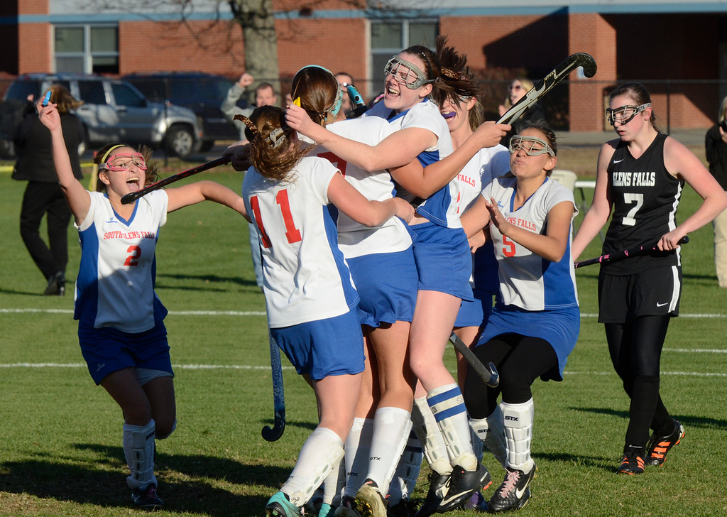 . Ed Burke - the Saratogian South High varsity field hockey players celebrate after Emily Sharpe\'s (7) goal during the Bulldogs 1-0 semi-final win over Glens Falls Tuesday at South Glens Fall High School.
