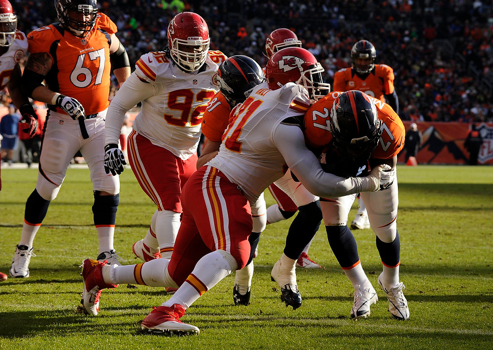 . Denver Broncos running back Knowshon Moreno (27) drives into the end zone in the first quarter as the Denver Broncos took on the Kansas City Chiefs at Sports Authority Field at Mile High in Denver, Colorado on December 30, 2012. Tim Rasmussen, The Denver Post