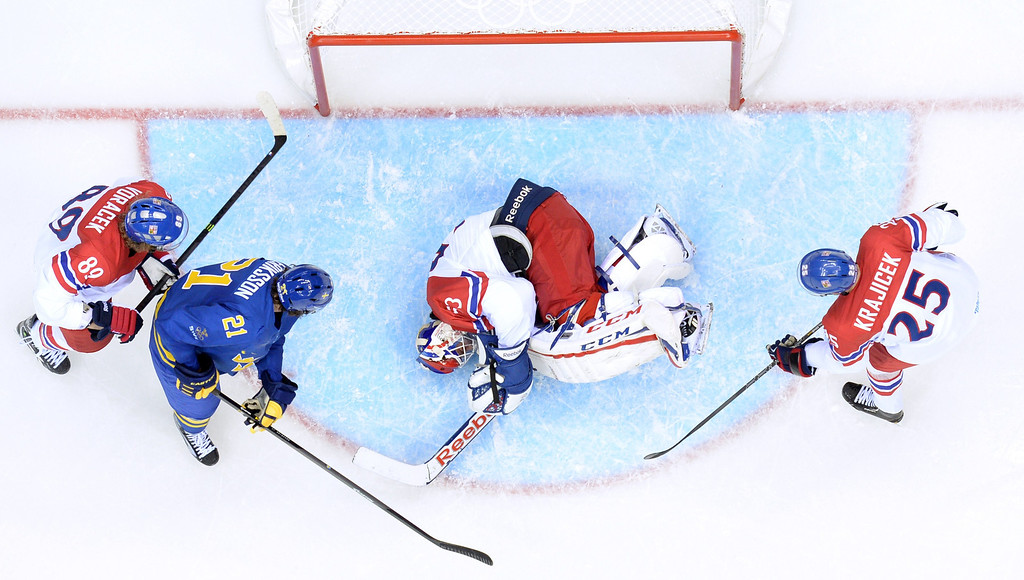 . Czech Republic\'s goalkeeper Alexander Salak (C) makes a save in front of Sweden\'s Loui Eriksson (2ndL) during the Men\'s Ice Hockey Group C match Czech Republic vs Sweden at the Bolshoy Arena during the Sochi Winter Olympics on February 12, 2014.    ALEXANDER NEMENOV/AFP/Getty Images