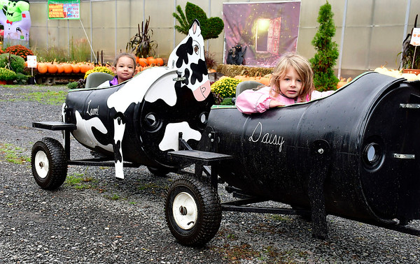 10/13/2018 Mike Orazzi | Staff Cousins Athena Lugo and Arianna Therrien enjoy a tractor ride during the Halloween Harvest Festival held at the Wojtusik Nursery on Terryville Avenue in Bristol Saturday. The festival continues weekends through October 28th.