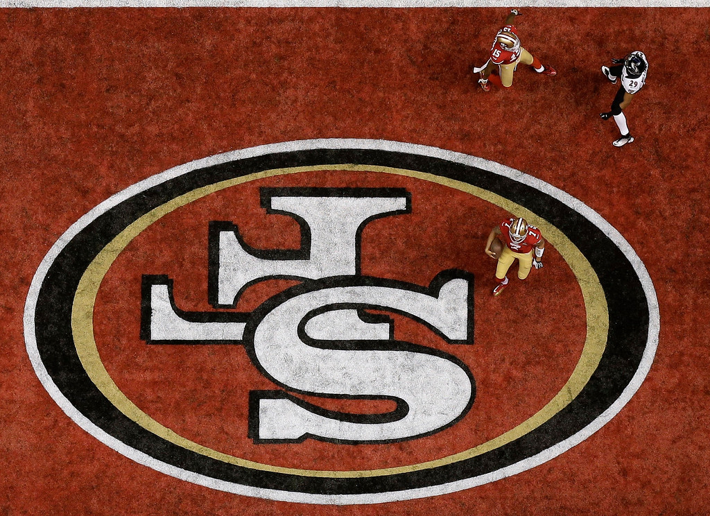 . San Francisco 49ers quarterback Colin Kaepernick (7) celebrates after scoring on a 15-yard touchdown run during the second half of the NFL Super Bowl XLVII football game against the Baltimore Ravens, Sunday, Feb. 3, 2013, in New Orleans. (AP Photo/David J. Phillip)