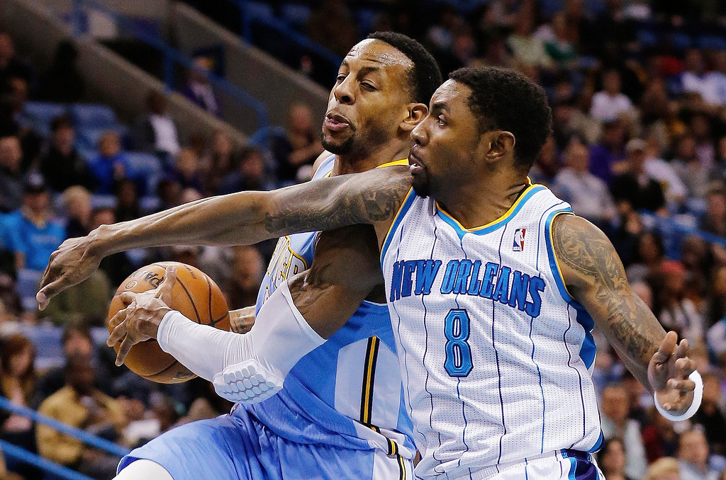 . Denver Nuggets guard Andre Iguodala (9) drives to the basket as New Orleans Hornets guard Roger Mason Jr., (8) defends in the second half of an NBA basketball game in New Orleans, Monday, March 25, 2013. The Hornets won 110-86. (AP Photo/Bill Haber)