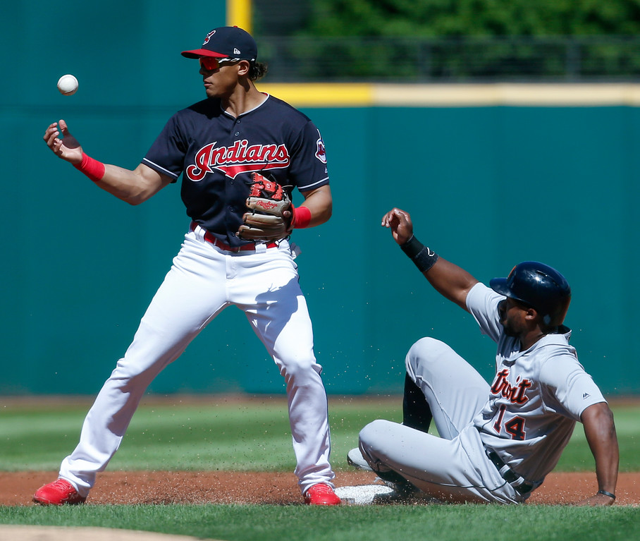 . Cleveland Indians\' Erik Gonzalez, left, forces out Detroit Tigers\' Christin Stewart at second base but then misplays the throw on a ball hit by Nicholas Castellanos during the first inning of a baseball game, Sunday, Sept. 16, 2018, in Cleveland. (AP Photo/Ron Schwane)