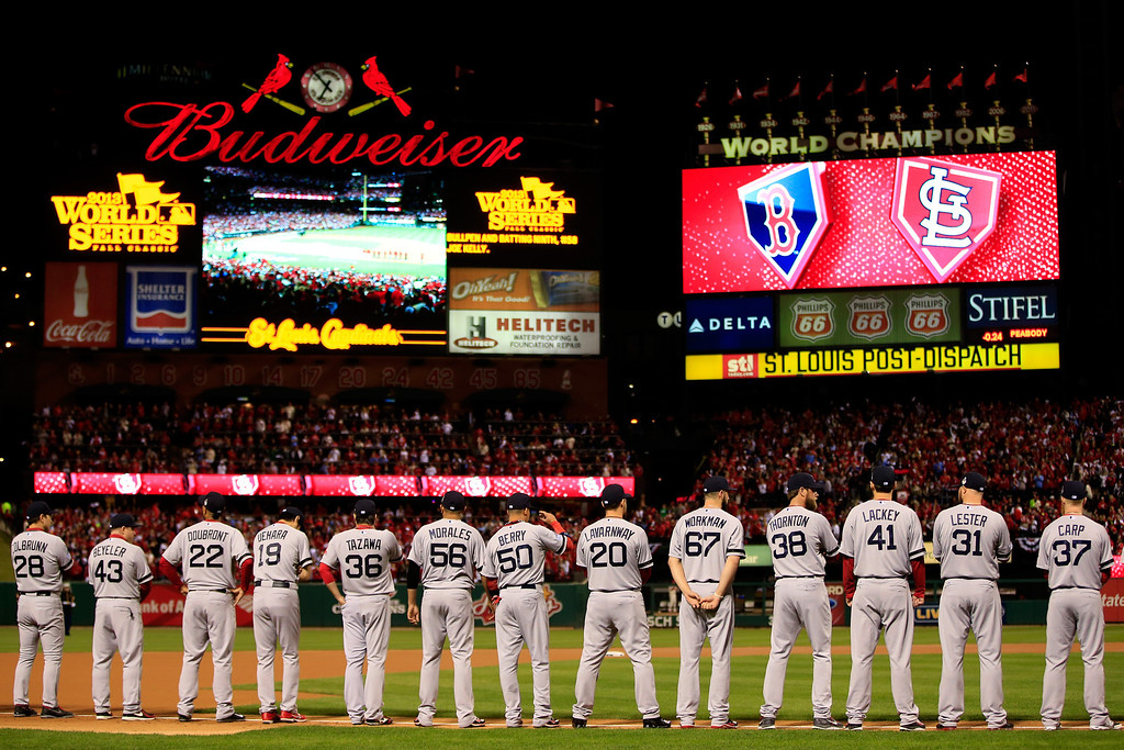 . ST LOUIS, MO - OCTOBER 26:  The Boston Red Sox line up during pre-game ceremonies for Game Three of the 2013 World Series against the St. Louis Cardinals at Busch Stadium on October 26, 2013 in St Louis, Missouri.  (Photo by Jamie Squire/Getty Images)