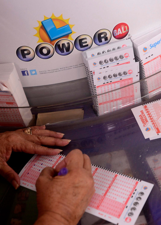 . Gloria Ybarra, of Fontana, picks numbers on a Powerball ticket at Quicker Liquor along Sierra Avenue in Fontana May 17, 2013.  The Powerball Lottery, which California just joined earlier this year, is at $600 million for Saturday\'s drawing.  It is the third-highest jackpot in U.S. history.  GABRIEL LUIS ACOSTA/STAFF PHOTOGRAPHER.