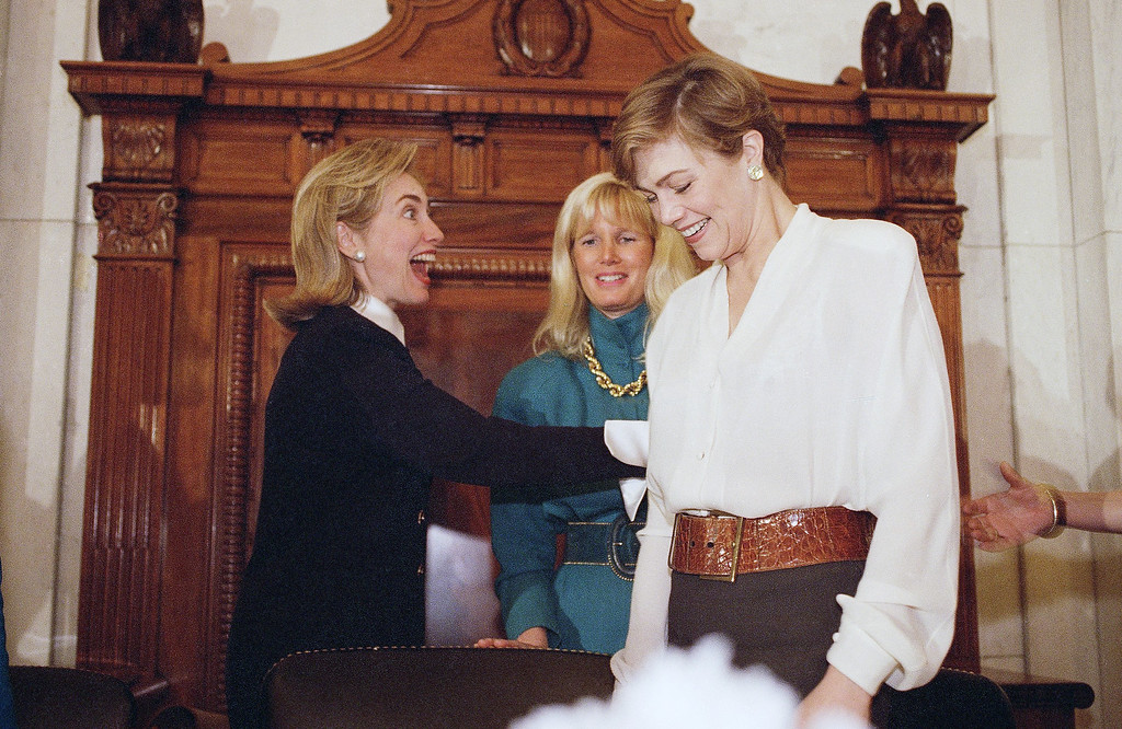 . First lady Hillary Rodham Clinton gestures toward actress Kathleen Turner, right, prior to addressing the Healthy Women 2000 conference at the Health Department in Washington, May 18, 1995. Assistant Surgeon General Susan Blumenthal is at center. (AP photo/Dennis Cook)