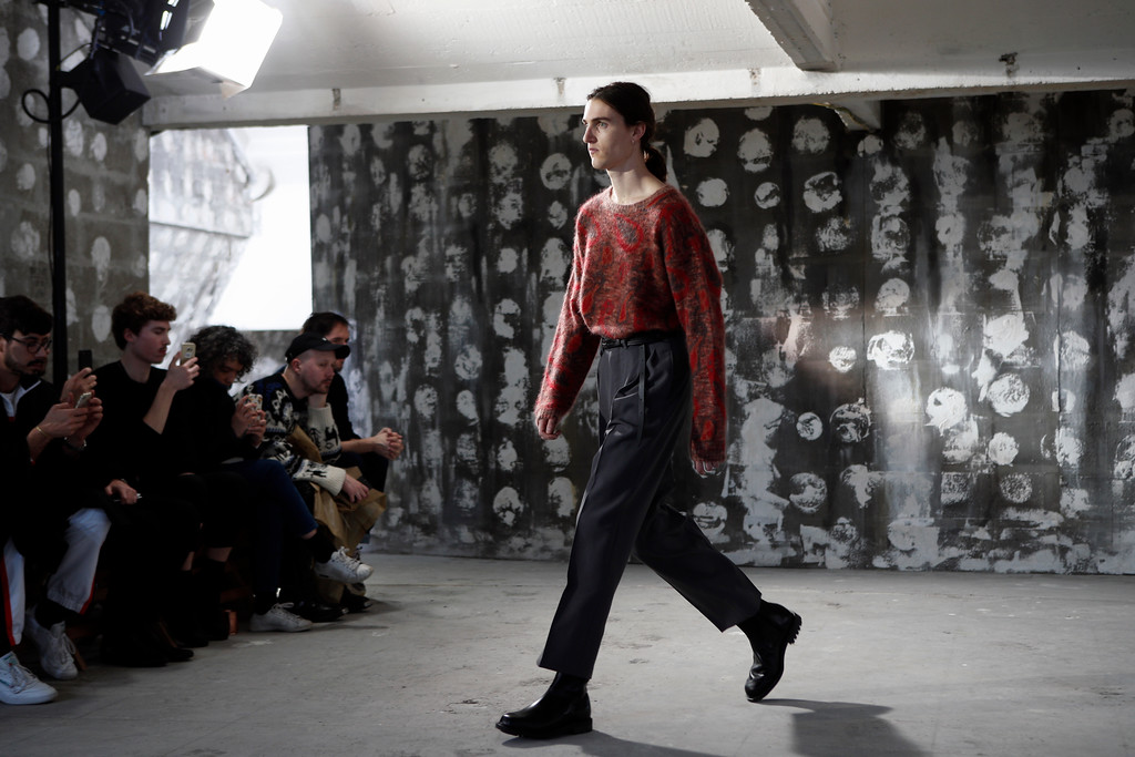 . A model wears a creation for Christophe Lemaire\' s men Fall-Winter 2018/2019 fashion collection presented in Paris, Wednesday, Jan.17, 2018. (AP Photo/Francois Mori)