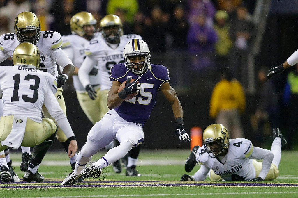 . Washington running back Bishop Sankey (25) runs the ball against Colorado in the first half of an NCAA college football game on Saturday, Nov. 9, 2013, in Seattle. (AP Photo/Ted S. Warren)