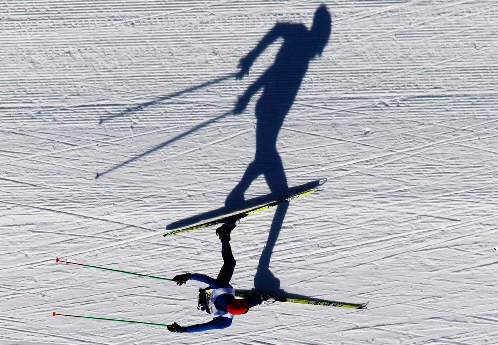 . A cross-country skier races during the Engadin Ski Marathon near Samedan March 10, 2013. More than 12,000 skiers participated in the 26.2 miles race between Maloja and S-chanf near the Swiss mountain resort of St. Moritz. REUTERS/Michael Buholzer