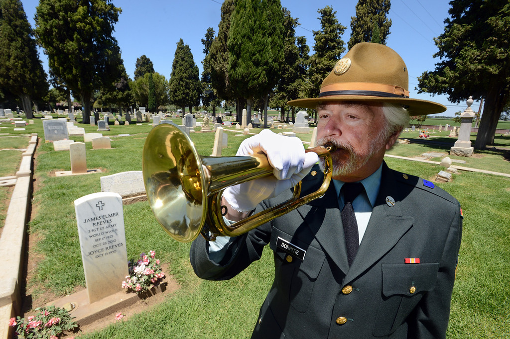 . Frank Dorritie plays taps  at the Union Cemetery on Thursday, May 23, 2013, in Brentwood, Calif. (Susan Tripp Pollard/Bay Area News Group)