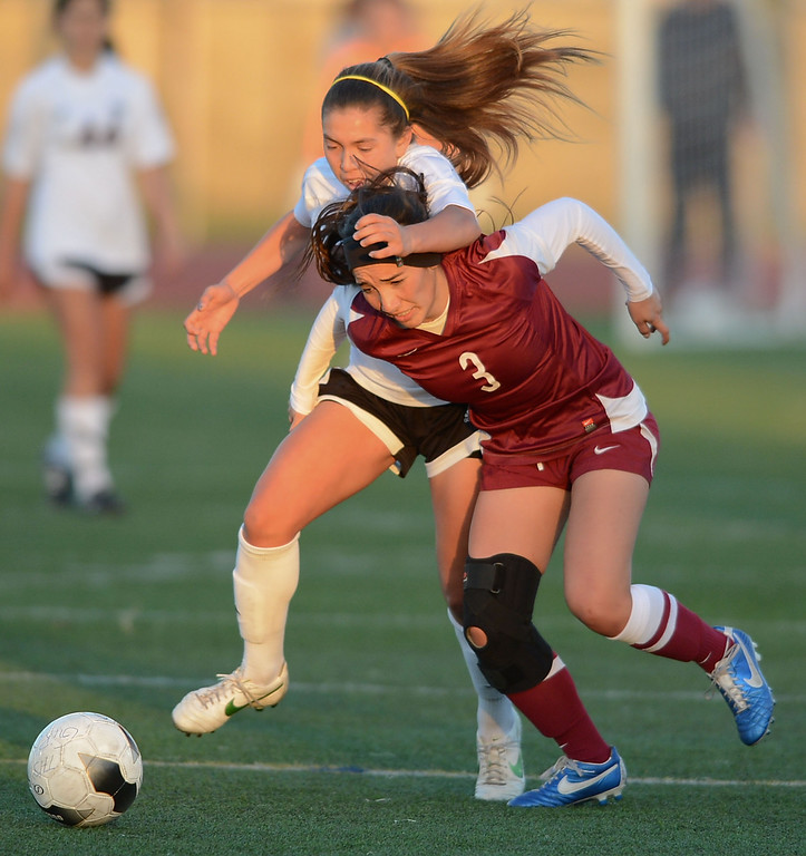 . Downey\'s Elizabeth Ham (3) and Torrance\'s Anika Rodriguez (77) get tangled while racing for the ball in a CIF SS Division IV quarterfinal game Thursday at Zamperini Field. Downey won the game 3-1. 20130221 Photo by Steve McCrank / Staff Photographer