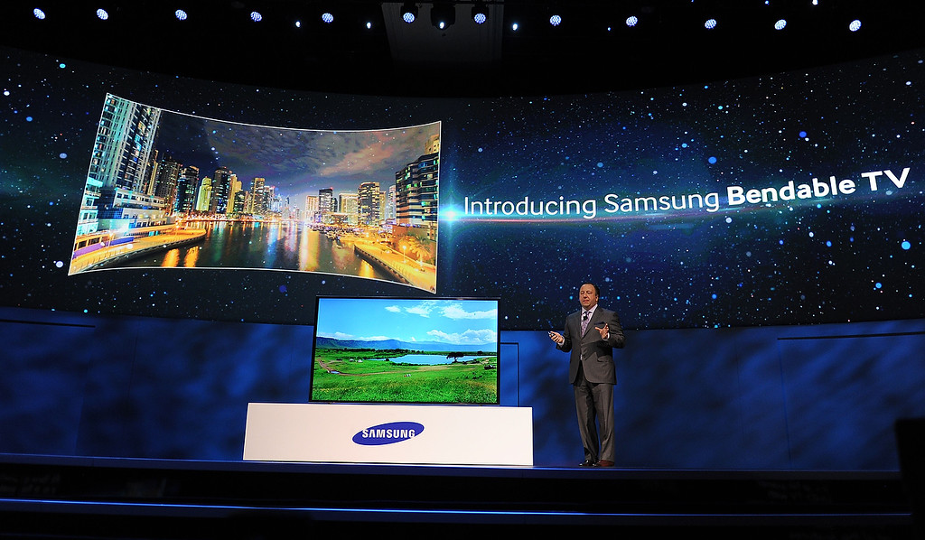 . Samsung Electronics America Executive Vice President Joe Stinziano introduces Samsung\'s new bendable television screen at the Samsung press event at the Mandalay Bay Convention Center for the 2014 International CES on January 6, 2014 in Las Vegas, Nevada. (ROBYN BECK/AFP/Getty Images)