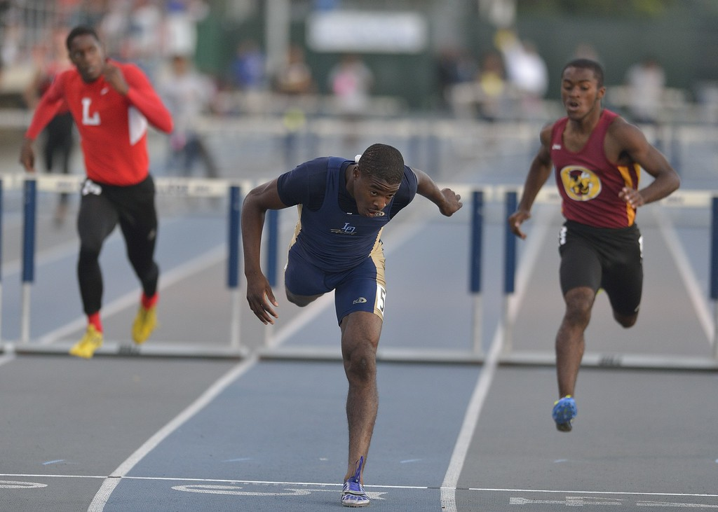 . NORWALK, CALIF. USA -- Los Osos\' Victor Bolden stumbles after coming off the last hurdle in the 300 meter hurdles during the CIF-SS Masters Track and Field Meet in Norwalk, Calif., on Friday, May 24, 2013. Photo by Jeff Gritchen / Los Angeles Newspaper Group