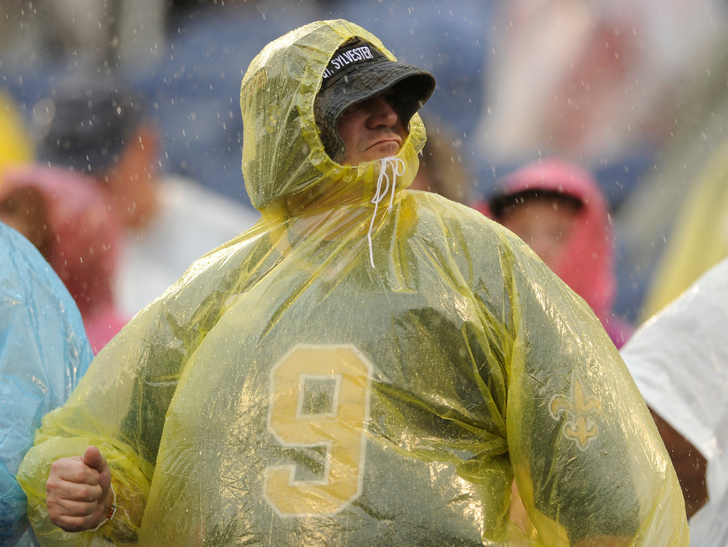 . A Pittsburgh Steelers fan watches the game during a downpour in the first half of the NFL Pro Bowl football game, Sunday, Jan. 28, 2018, in Orlando, Fla. (AP Photo/Steve Nesius)