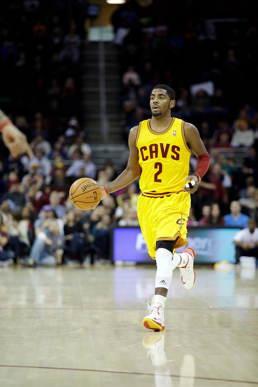 . Cleveland Cavaliers\' Kyrie Irving brings the ball up against the Milwaukee Bucks in an NBA basketball game Friday, Dec. 14, 2012, in Cleveland. (AP Photo/Mark Duncan)
