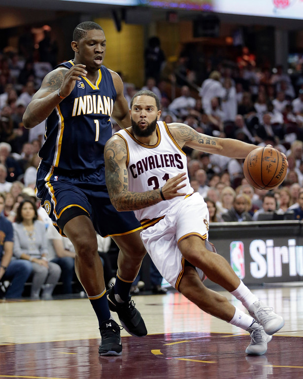 . Cleveland Cavaliers\' Deron Williams (31) drive past Indiana Pacers\' Kevin Seraphin (1), from France, in the first half in Game 1 of a first-round NBA basketball playoff series, Saturday, April 15, 2017, in Cleveland. (AP Photo/Tony Dejak)
