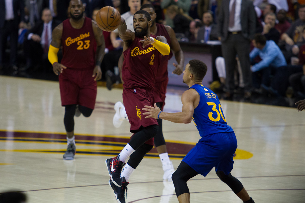 . Kyrie Irving (2) of the Cleveland Cavaliers makes a pass during an NBA game at the Quicken Loans Arena on Christmas day.  The Cavs defeated the Warriors 109-108.  Michael Johnson - The News Herald