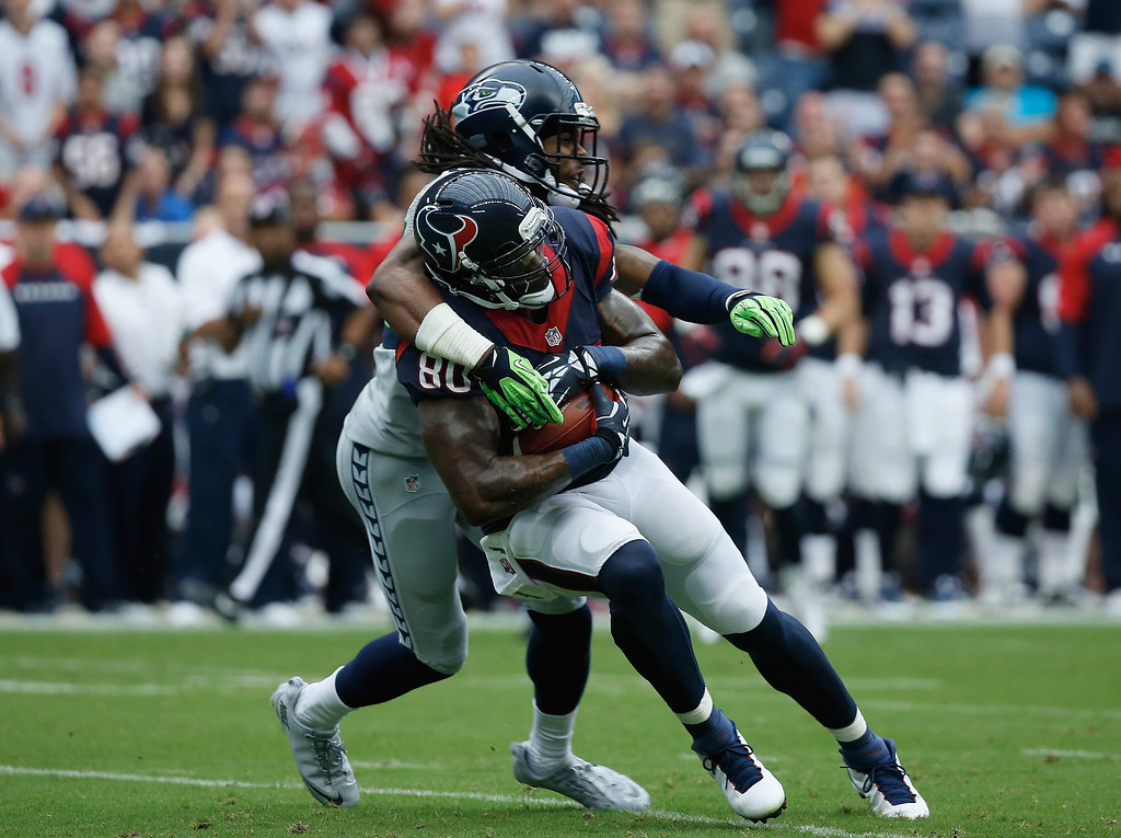 . HOUSTON, TX - SEPTEMBER 29:  Andre Johnson #80 of the Houston Texans hauls in a pass in front of Richard Sherman #25 of the Seattle Seahawks at Reliant Stadium on September 29, 2013 in Houston, Texas.  (Photo by Scott Halleran/Getty Images)