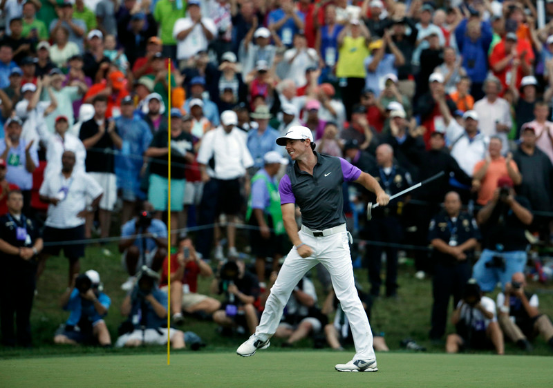 . Rory McIlroy, of Northern Ireland, celebrates after winning the PGA Championship golf tournament at Valhalla Golf Club on Sunday, Aug. 10, 2014, in Louisville, Ky. (AP Photo/Jeff Roberson)